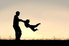foto of father child  - Silhouette of a happy father holding his little child - JPG