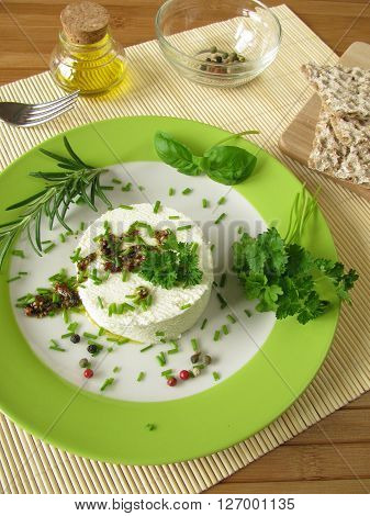 Goat cream cheese with herb marinade and colored pepper