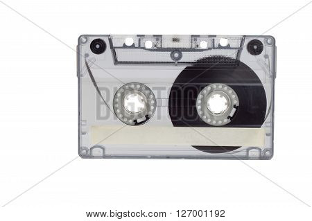 Old audio cassette isolated on white. Dusty damaged audio cassette, historical sound recording on magnetic tape. Place for your text.