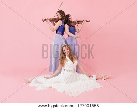 violin duet with the dancer on a pink background