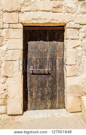 The old wooden door in the ancient nabatean town Shivta in the Negev desert, Israel