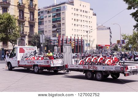 SPAIN, BARCELONA, JUNE, 27, 2015 - Truck transports Bicing city bikes in Barcelona, Catalonia, Spain. Bicycles are a large and important part of Barcelona's public transport system.