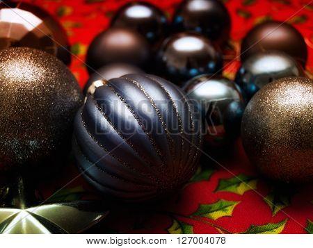 Closeup view of several dark Christmas balls.