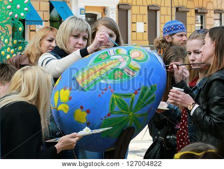 KYIV UKRAINE - April 23 2016. VI Ukrainian festival of Easter eggs. 374 Easter eggs in one and a half meters in height painted by masters-painters from all Ukrainian regions. Guests of the festival paint easter egg