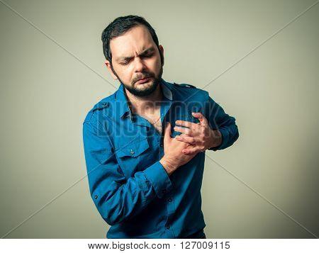 bearded man having the terrible heart pain