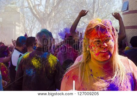 London Ontario, Canada - April 16: Portrait Of A Unidentified Young Girl With A Background Of People