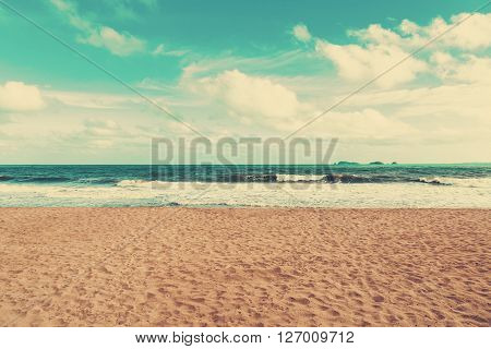 Retro Beach And Blue Sky With Vintage Tone.