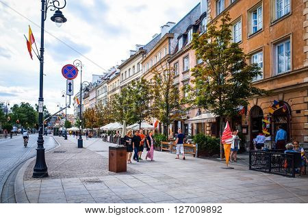 Warsaw, Poland - August 1 : Tourists on foot Street in Warsaw, Poland. is the capital and largest city of Poland. August 1, 2015 in Warsaw