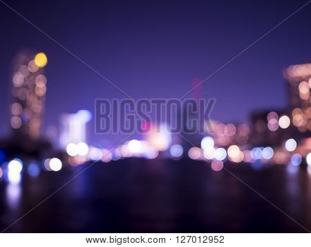 Night light bokeh blur background at Chao Phraya River in Bangkok Thailand with Purple color tone