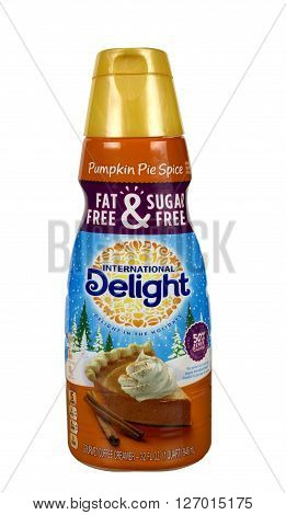 RIVER FALLS,WISCONSIN-APRIL 24,2016: A container of International Delight brand Pumpkin Pie Spice coffee creamer.