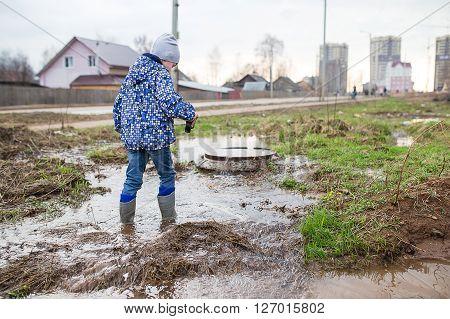 Child Wearing Rain Boots