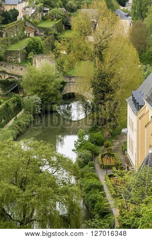 This is fragment Alzette river valley in the city at the walls of Upper Town of Luxembourg.