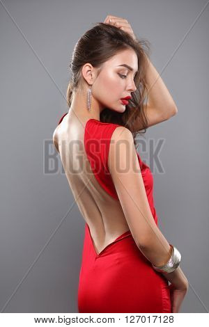 Young beauty woman in red dress