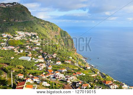 Landscape with Madeiran coastal village in Portugal