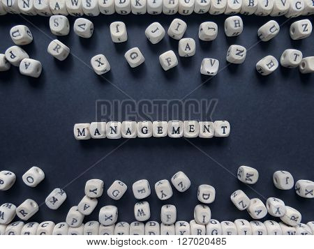 Word Management Of Small White Cubes Next To A Bunch Of Other Letters On The Surface Of The Composit