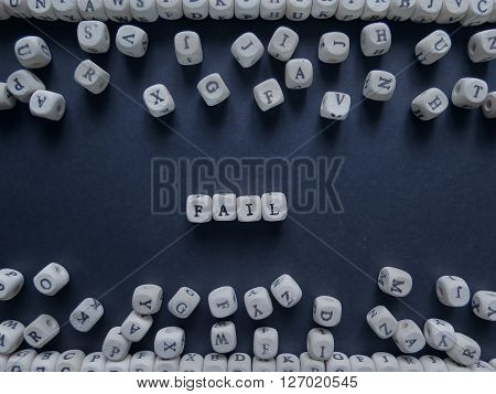 Word Fail Of Small White Cubes Next To A Bunch Of Other Letters On The Surface Of The Composition On