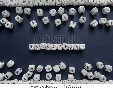Word Emancipate Of Small White Cubes Next To A Bunch Of Other Letters On The Surface Of The Composit