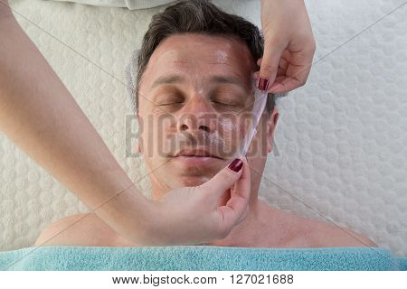 Top View Of Man Having Pore Cleaning Procedure In Parlor