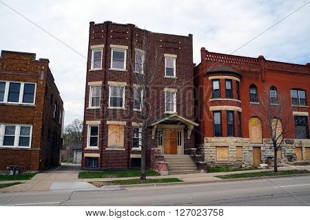 JOLIET, ILLINOIS / UNITED STATES - APRIL 19, 2015: An abandoned brick apartment building in a residential area of Joliet.