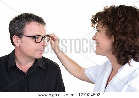 Female Optician Offering Glasses Frames To Male Customer And Smiling Friendly