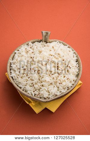 jeera rice, long-grain basmati rice flavoured with fried cumin seeds , served in a ceramic bowl