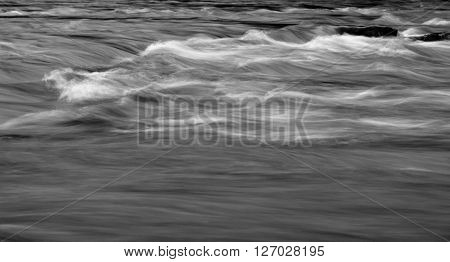 Mountain river rushing water flowing texture at cloudy day