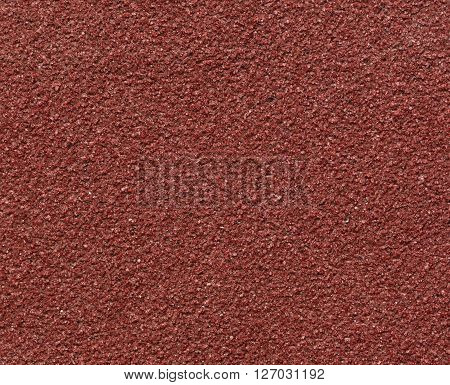 Red sandpaper texture macro shot background (closeup)