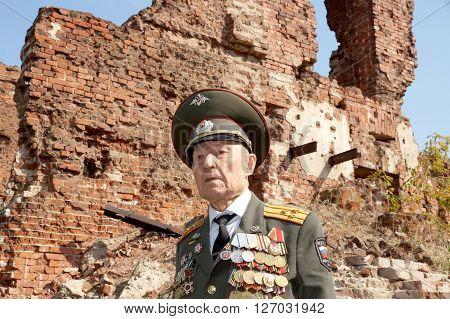 Defender of Stalingrad veteran of World War II colonel Vladimir Semenovich Turov against Stalingrad military ruins