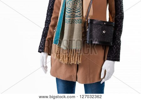 Handbag and scarf with fringe. Mannequin wearing purse and scarf. Small retro purse and outerwear. Lady's dark accessory from magazine.