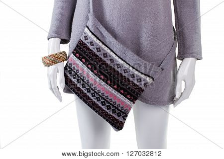 Warm top, purse and bracelet. Tunic and bracelet on mannequin. Lady's warm high-quality clothes. Trendy pattern bag on sale.