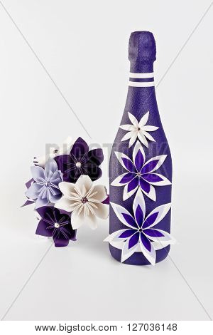 Bottle of champagne and origami wedding bouquet