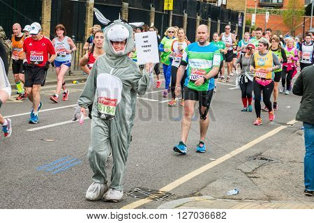 London United Kingdom - April 24 2016: London Marathon 2016. Runners in great costumes. Donkey costume with