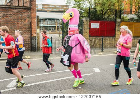 London United Kingdom - April 24 2016: London Marathon 2016. Runners in great costumes. Pink Flamingo costume
