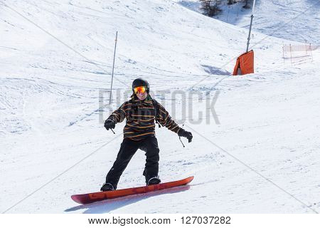 View of a snowboard model in the ski resort Les Orres in France