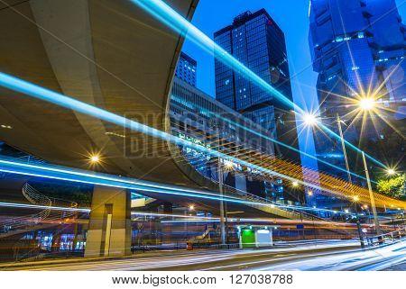 light trails through the footbridge,hongkong china.