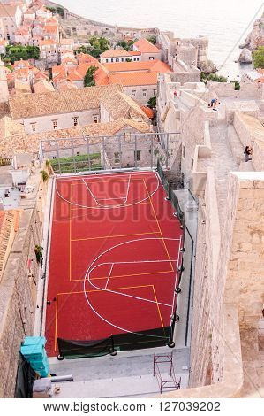 DUBROVNIK CROATIA - AUGUST 31 2009: Small basketball court crammed amongst the houses and walls