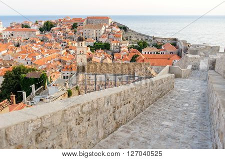 Ramparts on the west wall of Dubrovnik old city with a partial view of the city