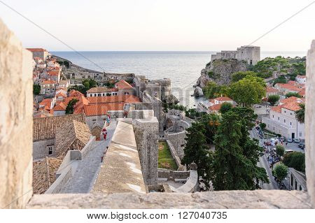 DUBROVNIK CROATIA - AUGUST 31 2009: Ramparts of the west wall of Dubrovnik old city and St. Lawrence fort