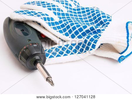 Cordless electric screwdriver and work gloves with a pattern