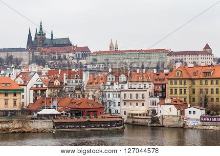PRAGUE, CZECH REPUBLIC - FEBRUARY 13, 2015: Charles Bridge a famous historic bridge that crosses the Vltava river in Prague on February 13 2015. Prague is the capital and largest city of Czech Republic.