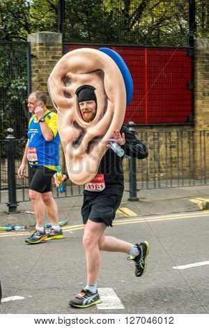 London United Kingdom - April 24 2016: London Marathon 2016. Runners in great costumes. Giant Ear with hearing aid costume