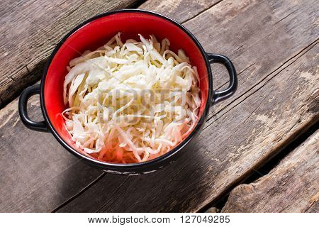 Sauerkraut in a bowl. Bowl of sauerkraut on table. Special ingredient for a salad. Product that has sour taste.