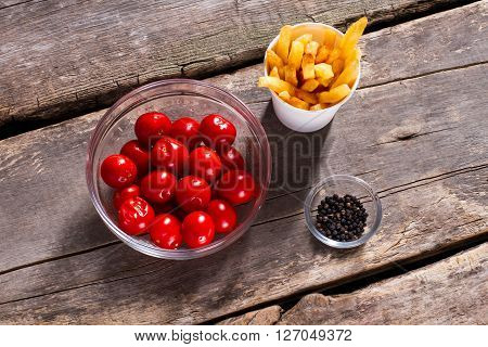 Tomatoes with fries and pepper. Pepper and tomatoes on table. Don't add too much spice. Vitamins and energy.
