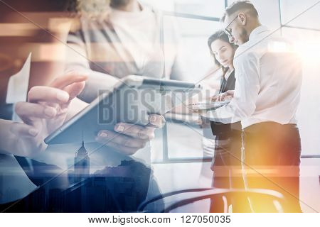 Business team work process.Double exposure photo professional crew working with new startup project.Investment managers meeting. Analyze business plans laptop.Blurred, film and bokeh effect.