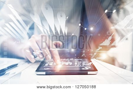 Photo female hand touching modern tablet.Investment manager working new private banking project office.Using electronic device. Graphic icons, worldwide stock exchanges interface on screen.