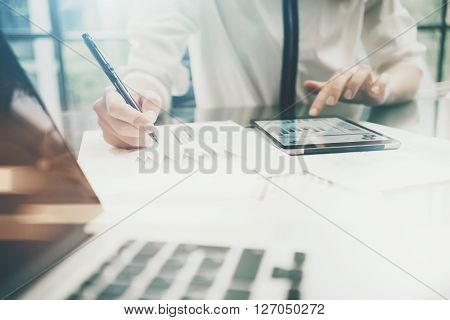 Investment manager work process.Photo business woman touchig modern tablet screen report.Statistics graphic screen.Banker  signs document, new startup, marketing plans.Horizontal, bokeh and film