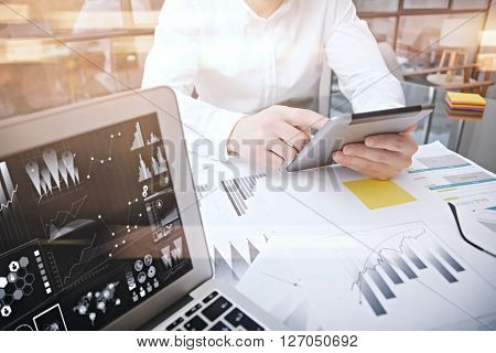 Photo man work market report modern tablet.Using electronic devices.Graphic icons, stock exchange reports screen laptop.Horizontal