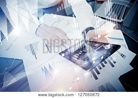 Investment manager working process.Photo trader work market report modern tablet.Using electronic device.Graphic icons, stock exchanges report screen.New business project startup.Horizontal