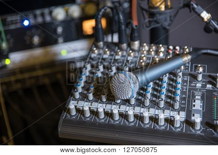 Clean shot of a microphone (mic) ready to be grabbed and used.