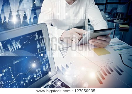 Concept businessman touching modern tablet screen.Trader manager working new private banking project office.Using electronic device.Graphics icons, worldwide stock exchanges interface